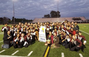 West Valley's Band holding their State Champions banner on the football field.