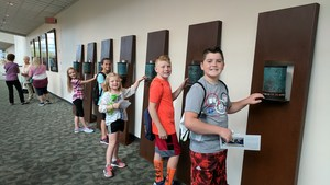 Elementary students check out one of the hands-on exhibits at ArtPrize.