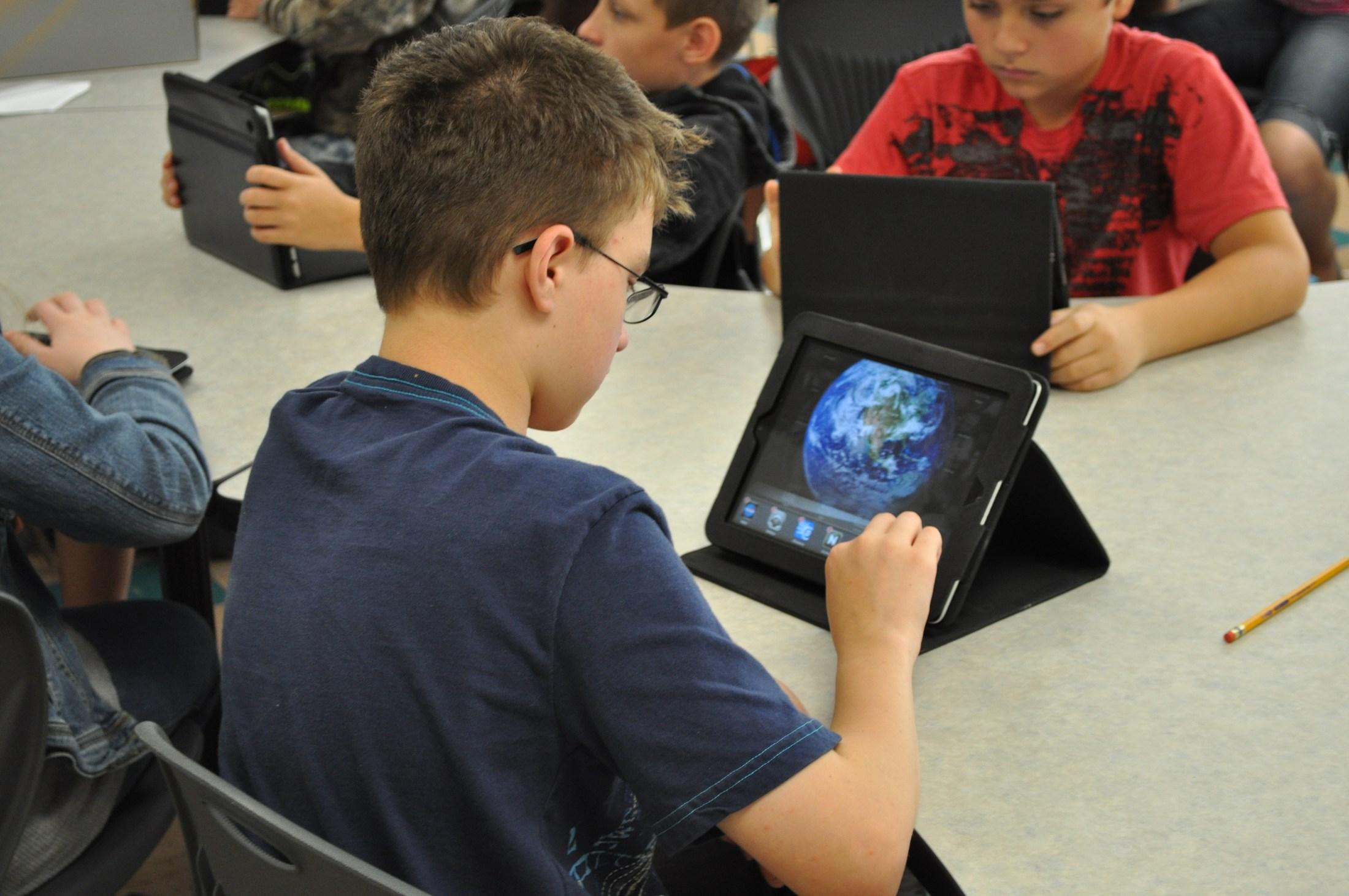 Student working on iPad