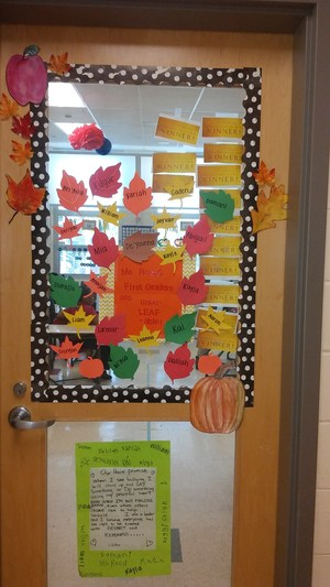 Ms. Reed's 1st grade class door decorated with winning stickers for walking in the halls correctly