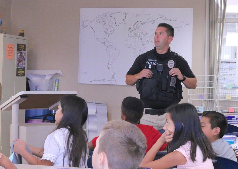 Officer Dombrowski presenting the dangers of alcohol to students.