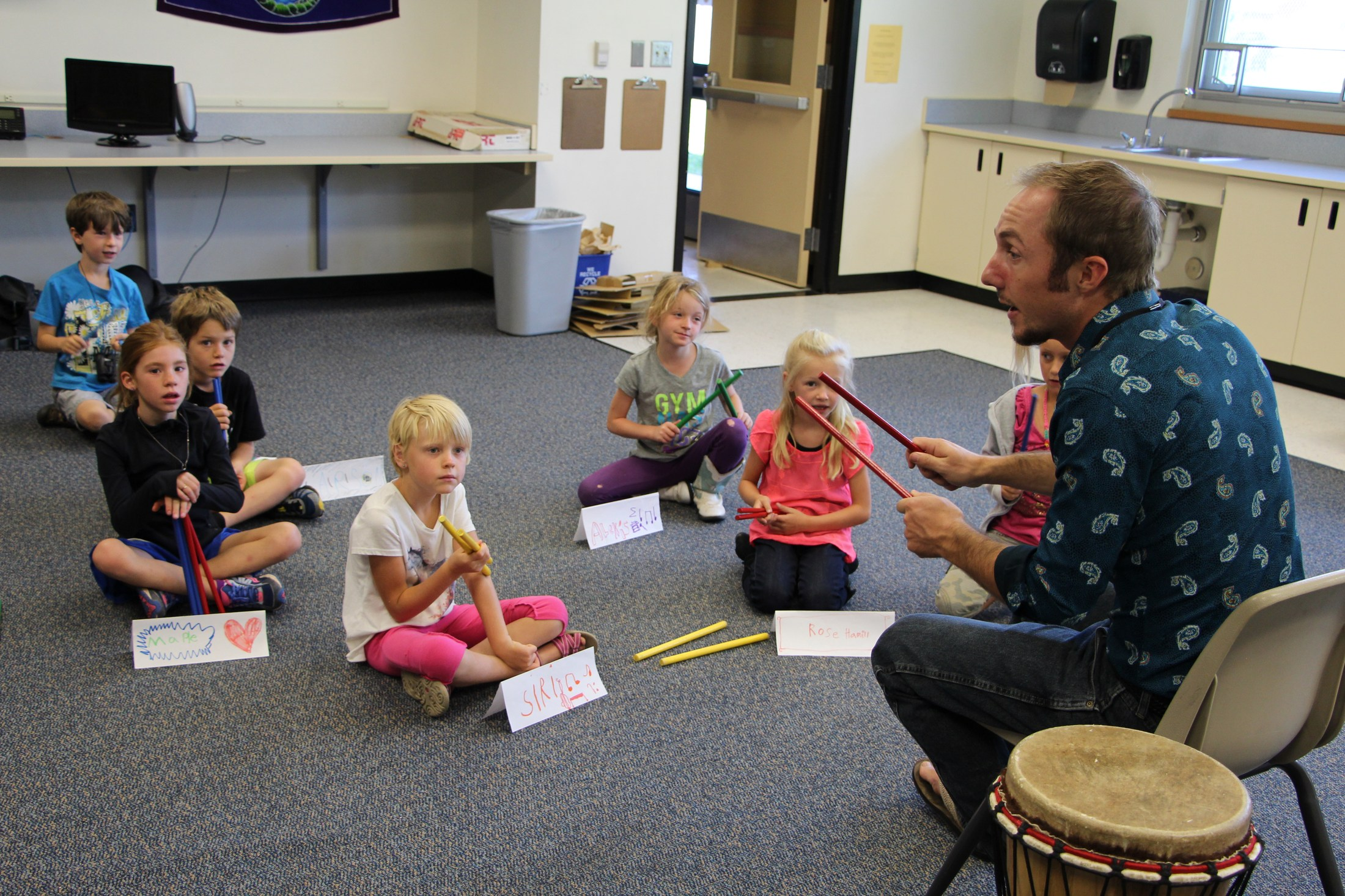 Students participate in music class at Shared School.