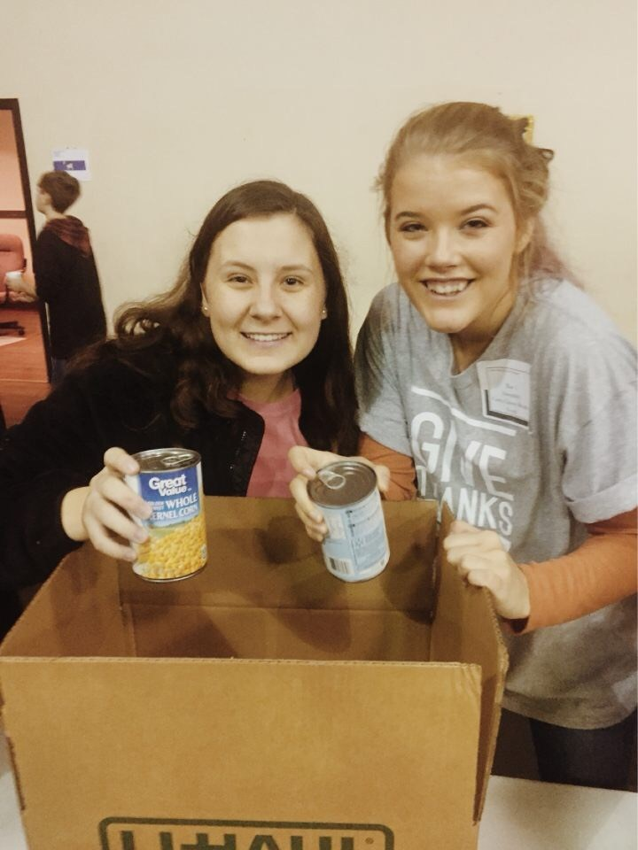 Smile club students packing boxes of supplies