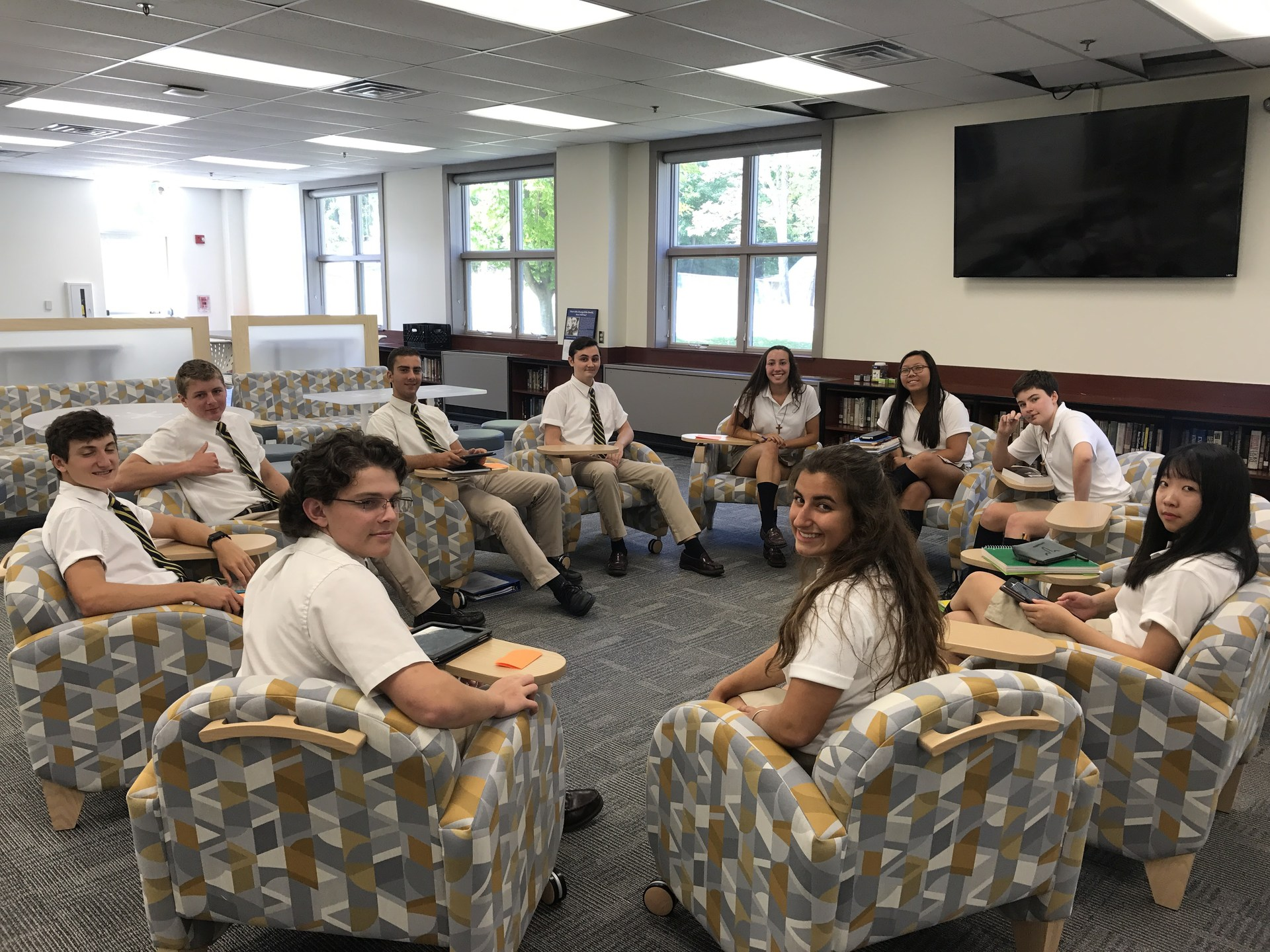 Students sitting in circle in Biondo Research Center