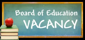 Chalkboard with book & apple announcing Board of Education VACANCY