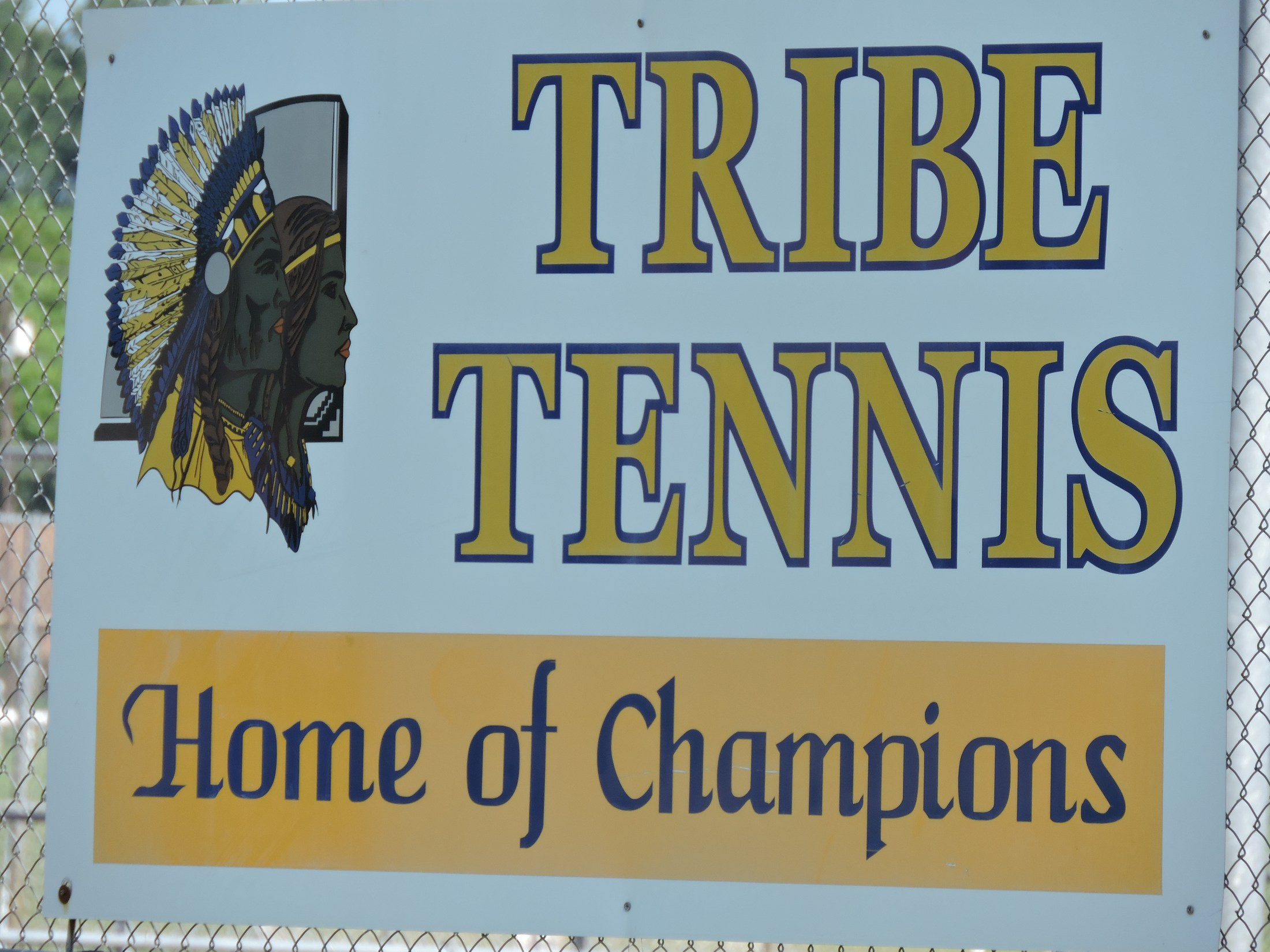 Tribe Tennis sign at the tennis courts