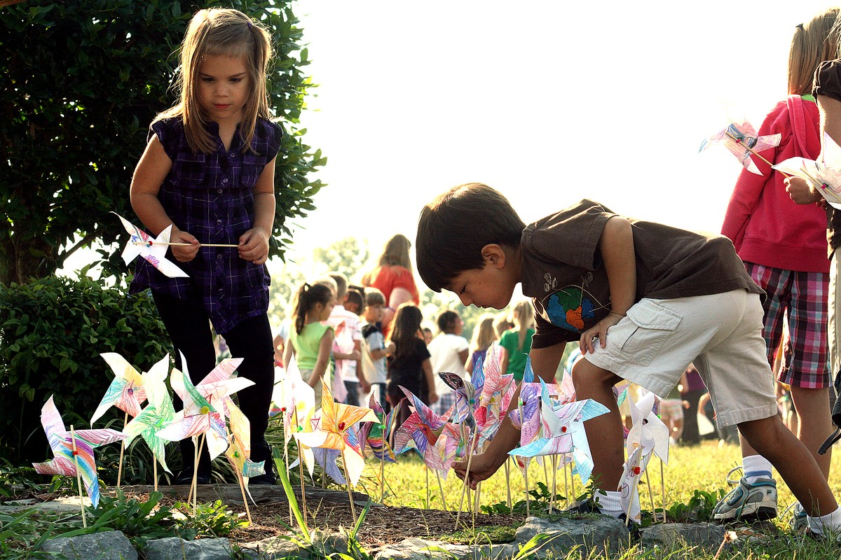 Photo of students planting windmills