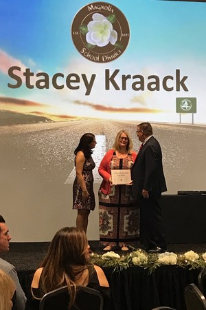 Stacey Kraack onstage receives award