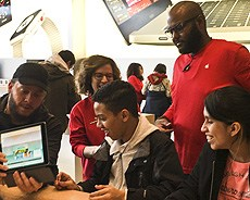 NYI students at the apple store learning about coding