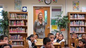 Linda Tovar observes a classroom at Midkiff Elementary