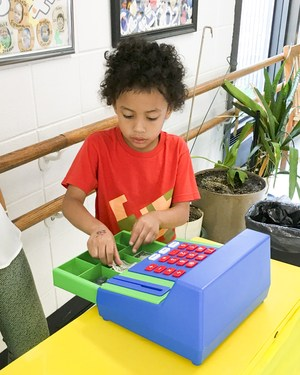 student working the register