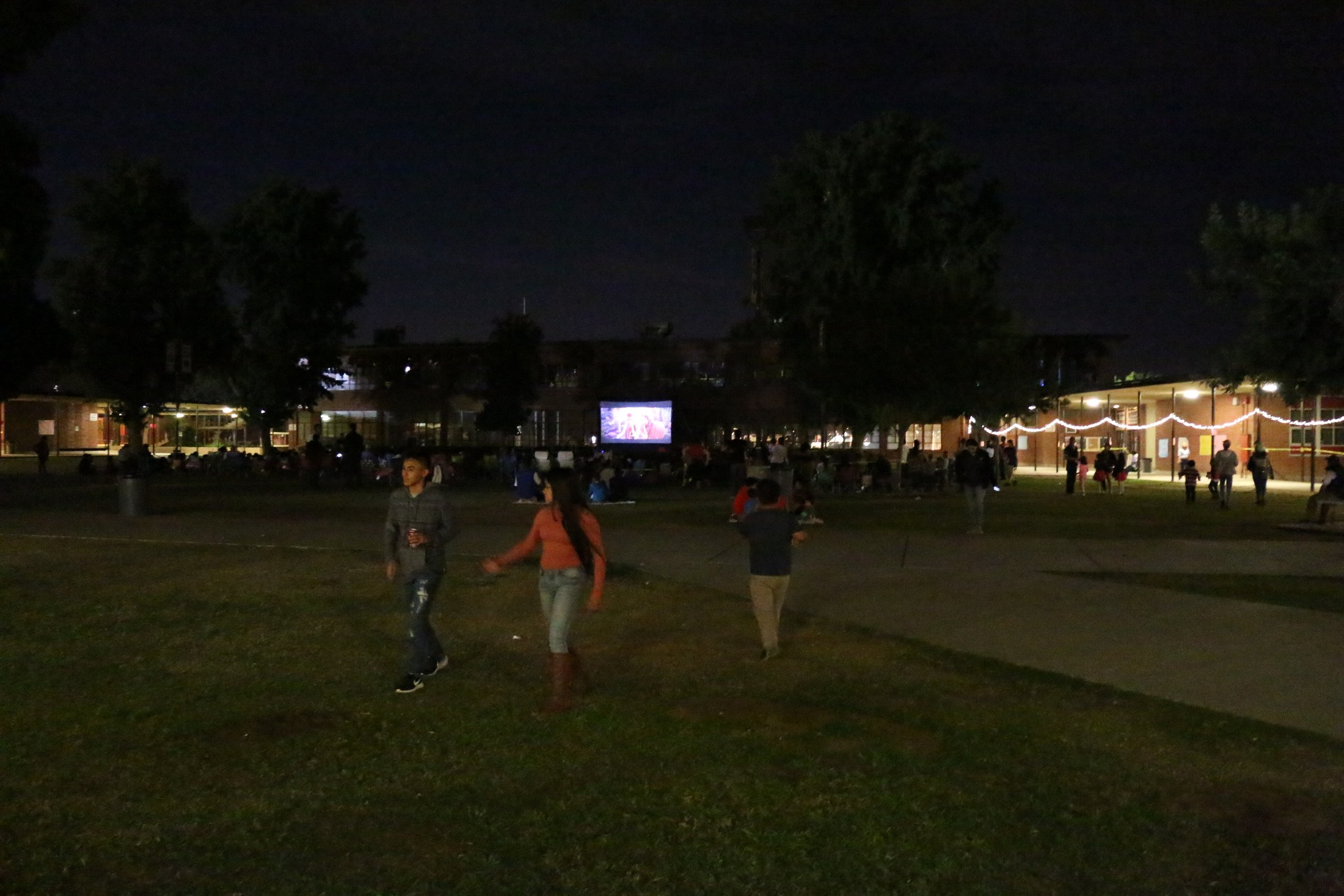 Students and family gathered on the lawn of Arvin High to watch a movie on the big screen as a part of the After school family movie night.