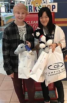 Thornapple Kellogg sophomore Eryn Schell and Japanese exchange student Sawa Mekata visit RiverTown Crossings in Grandville