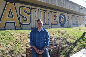 Allen Kruse in front of the ASPIRE sign