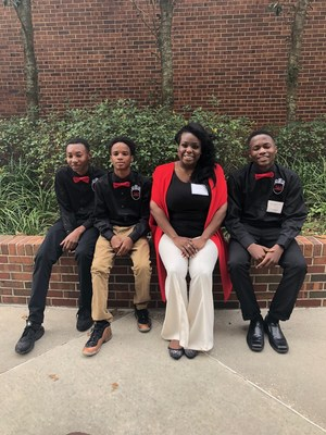 Photo of BMS JAG boys with teacher at the Lafayette Conference