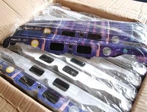 Box of solar eclipse glasses