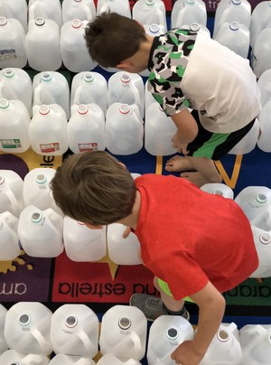 kindergarteners counting milk jugs