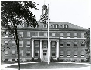 Front of Schermerhorn Hall as viewed from Pelham Parkway with the flag in front.