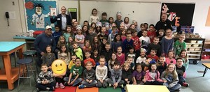 First grade students with celebrity readers