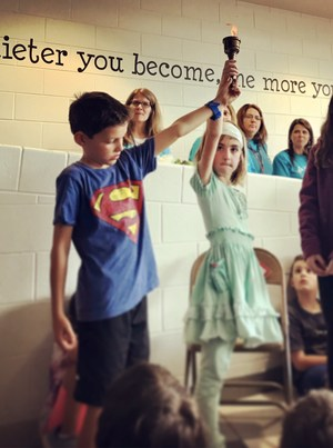 Winchester students and staff passed a torch as they told the story of their The Leader in Me journey.