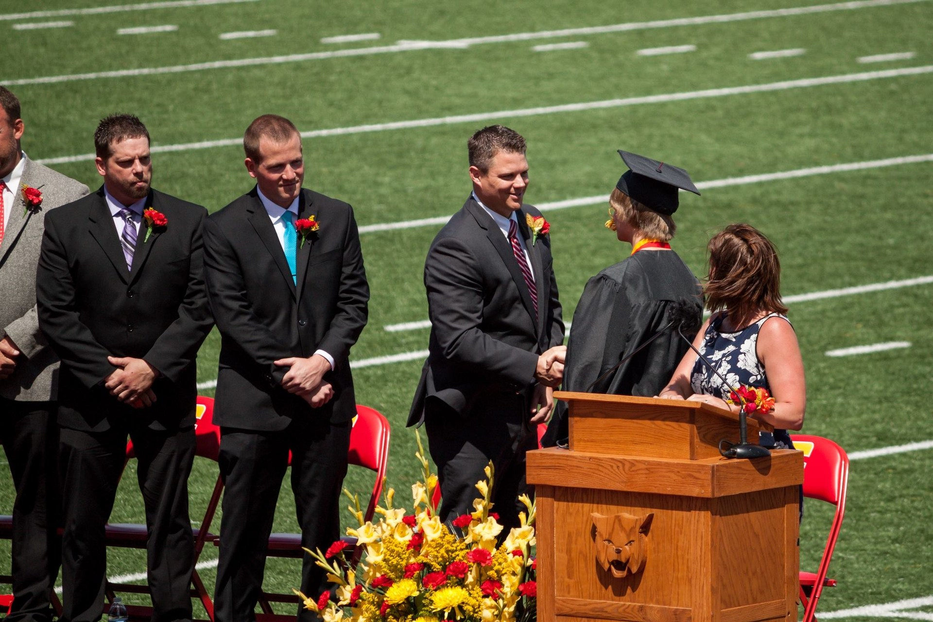 Blackmore shaking hands with student