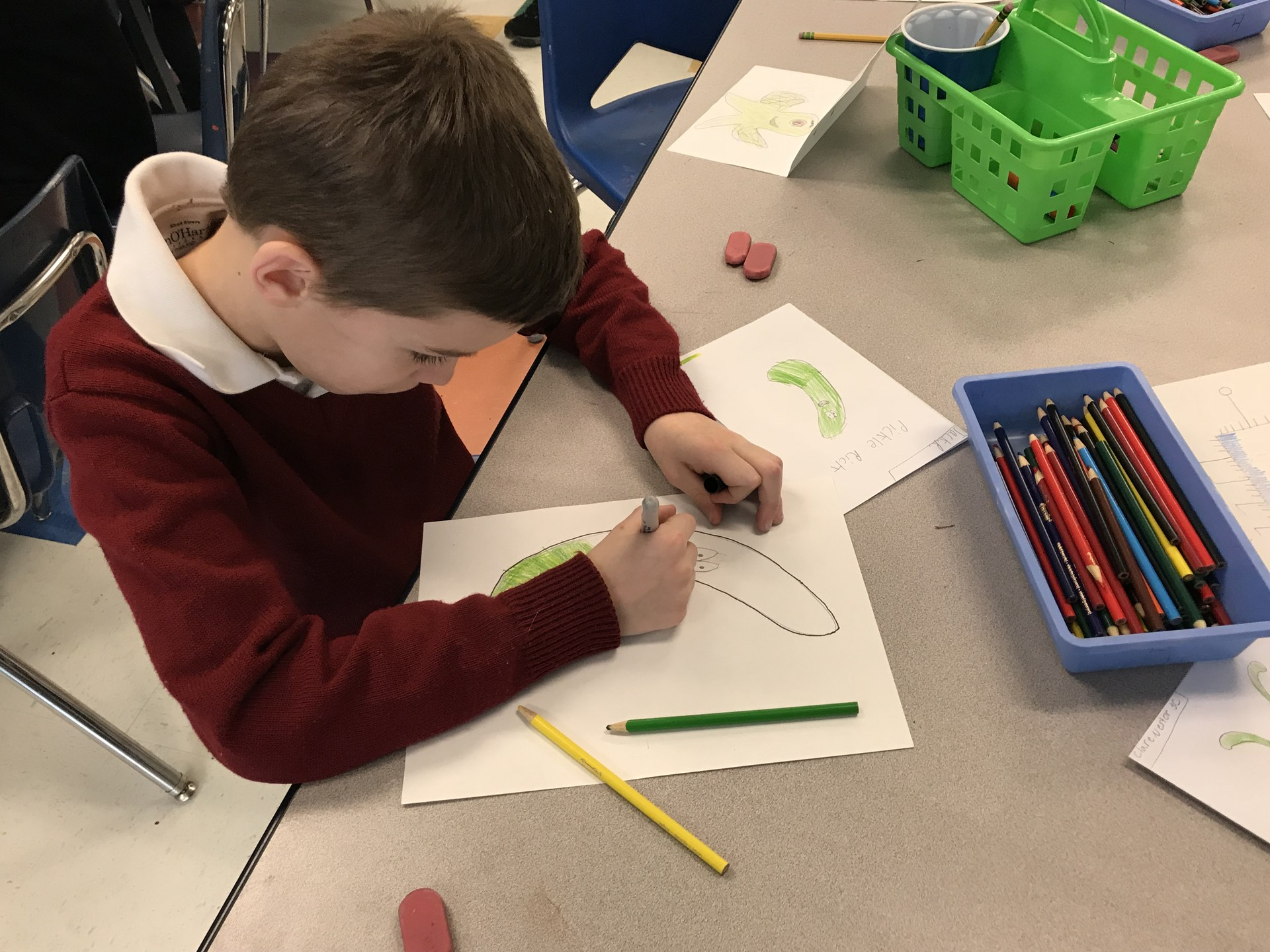 Student drawing picture of a character