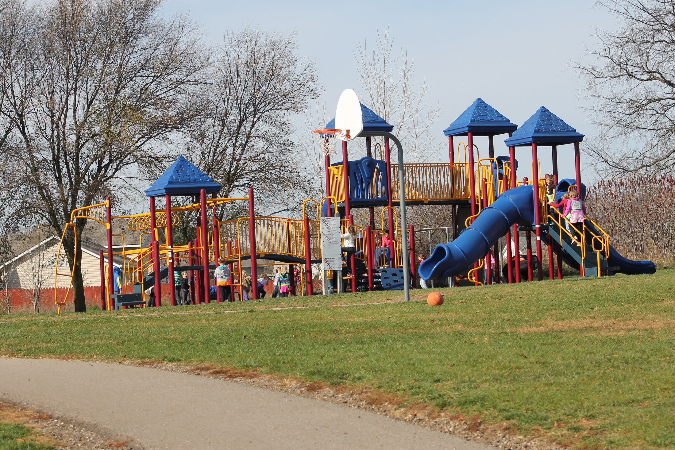 Elementary students enjoy safe and fun playground equipment.