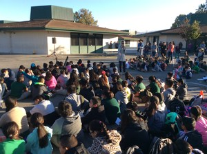 large group of students on blacktop for assembly, image 2