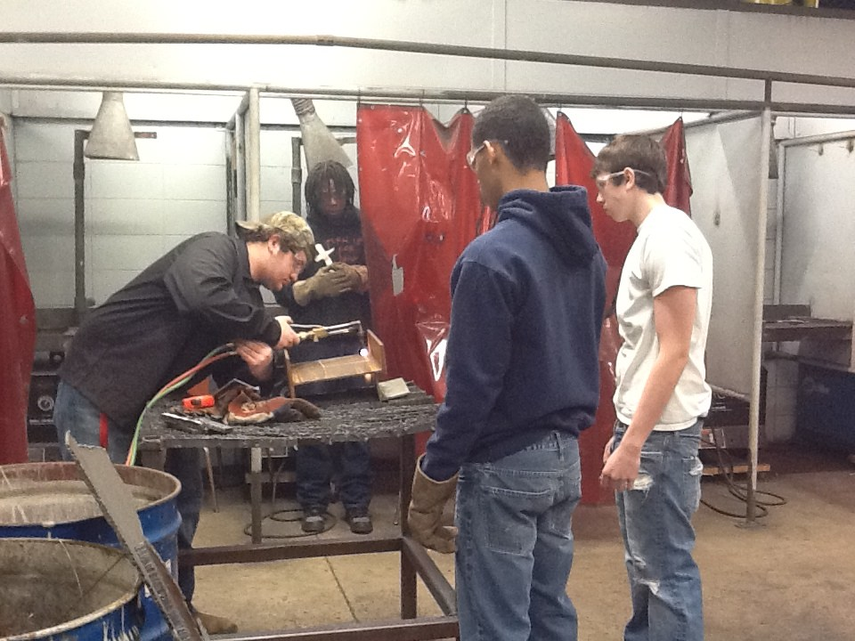 Welding students in the shop
