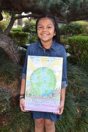 Kassandra Prieto Holds her Winning Poster