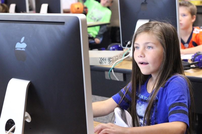 Girl at iMac computer