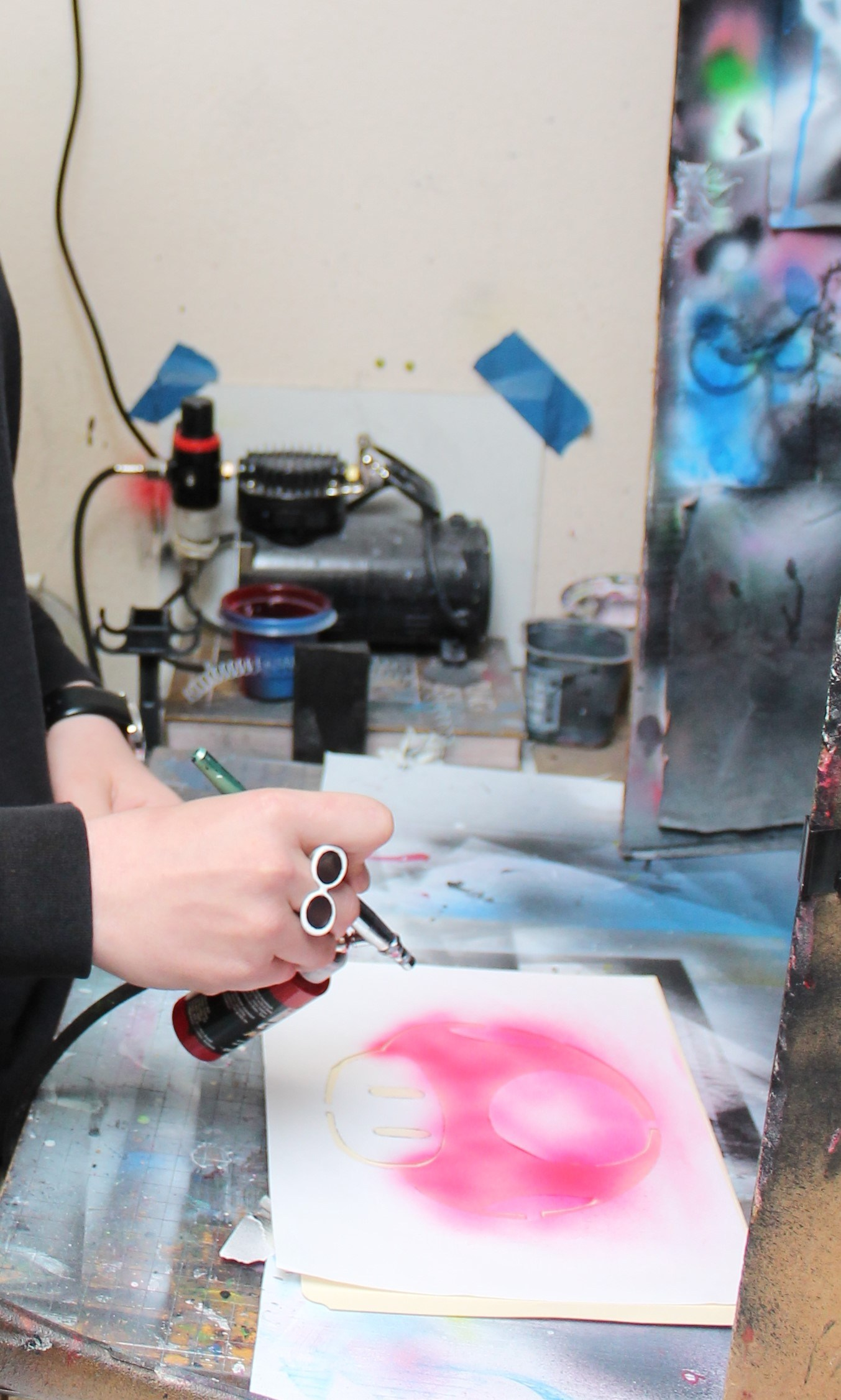 Student painting with the airbrush
