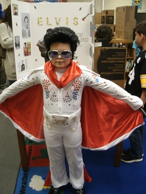 Student dressed as Elvis Pressley in wax museum.