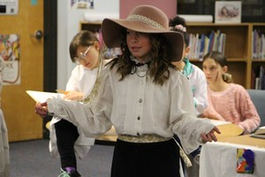 Students present on Women's History in Colorado.