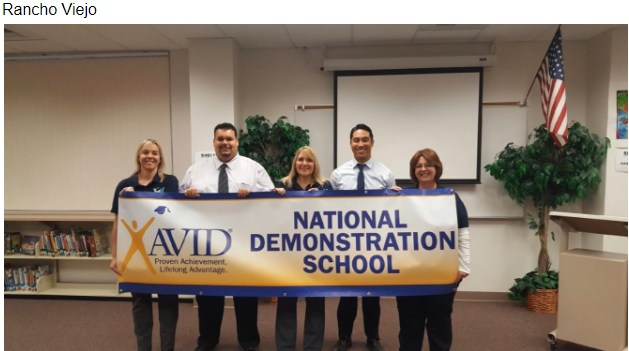 Photo of the Rancho Viejo AVID Staff Members holding their National Demonstration School banner
