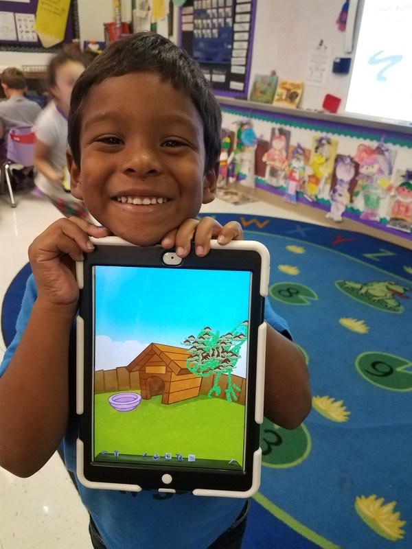 Kindergarten boy uses Doodle Buddy app to draw turkey in unusual location
