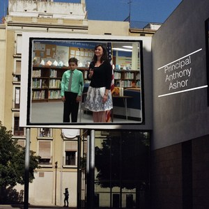 principal and student on a billboard on a building