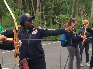 girls practice their archery skills