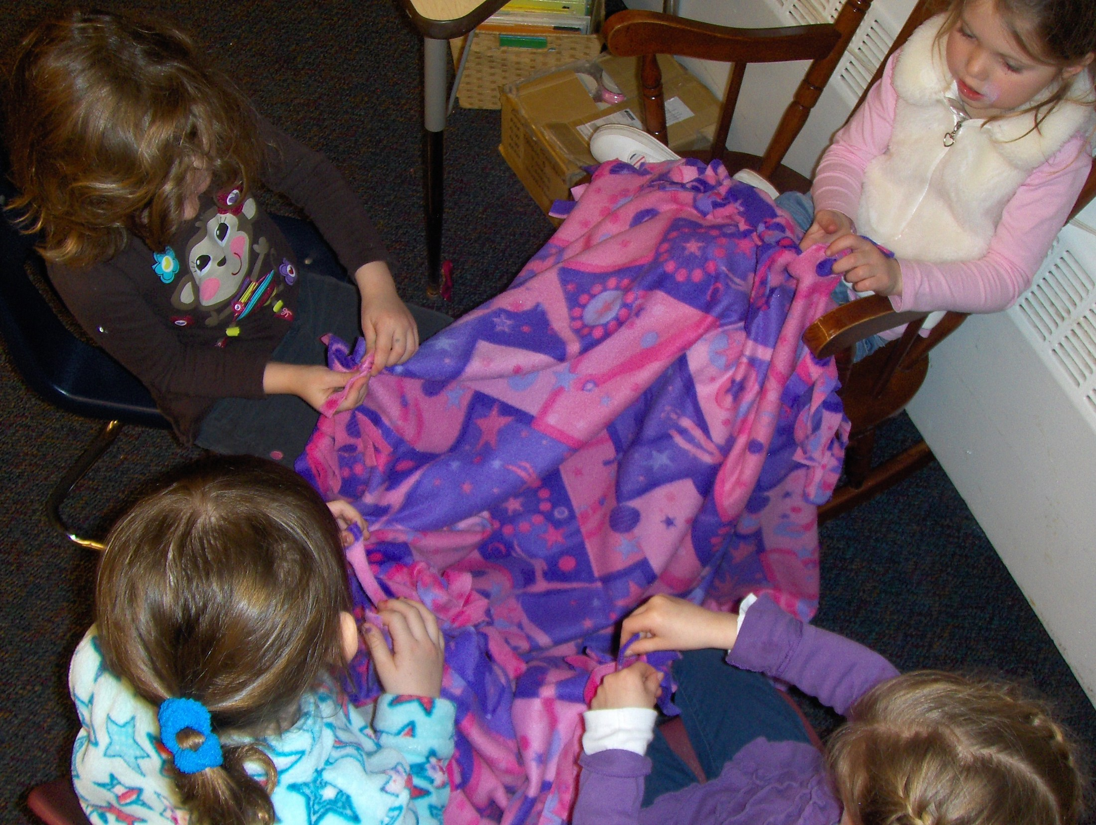 Girls making a blanket for Community Service Project.
