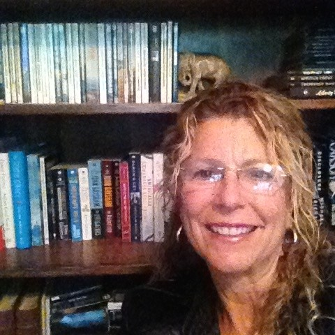Picture of Mrs. Larash and home library
