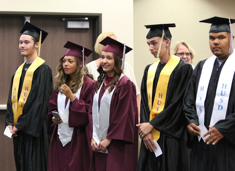 Graduates standing during the Pledge of Allegiance