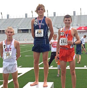 Distance runners displaying medals at regional track meet
