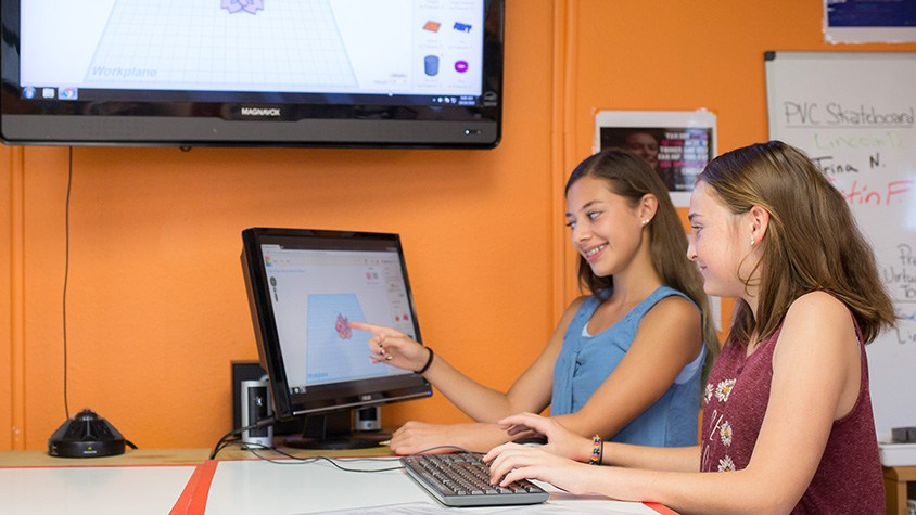 Two female students work on a computer to create 3D image