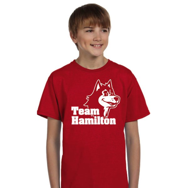 A child wearing a Team Hamilton shirt.