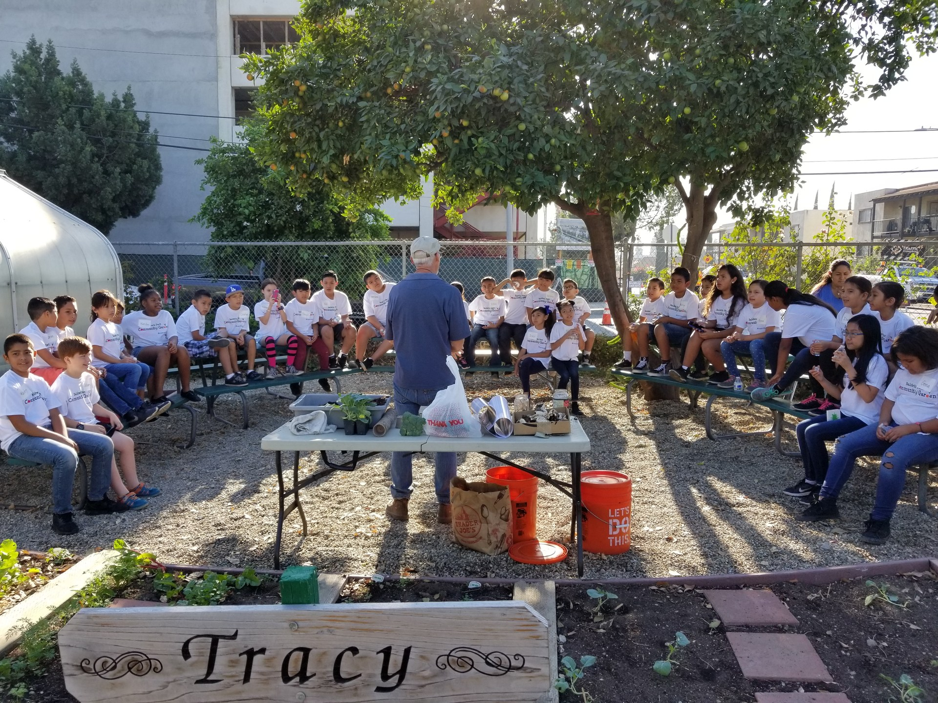 Fourth-graders from De Anza Elementary School listen to a talk about planting and tending fruits and vegetables on Oct. 27 as part of the District's Nutrition in the Garden program. The yearlong program teaches students about food preparation and healthy nutrition.