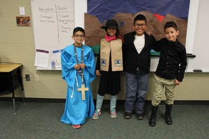 Students present on early Spanish settlers in Colorado.