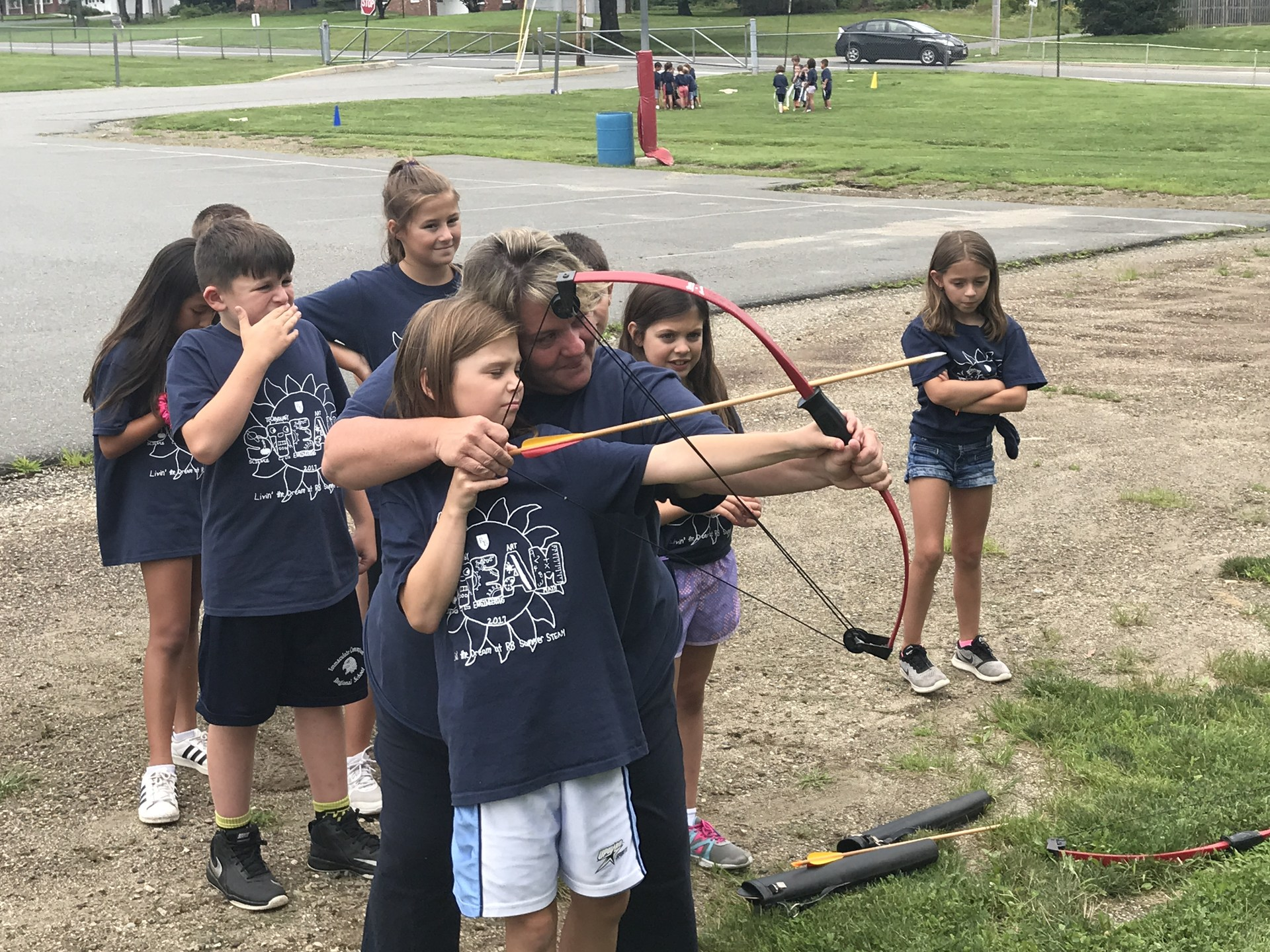 Student doing an archery lesson during Summer STEAM