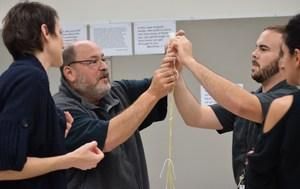 Teachers making tower of spaghetti.