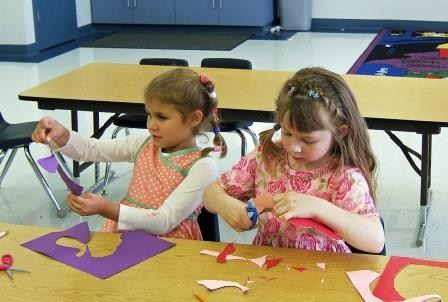 Campers working on crafts.