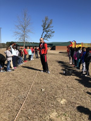 Mr. Vaughn teaching class outside.